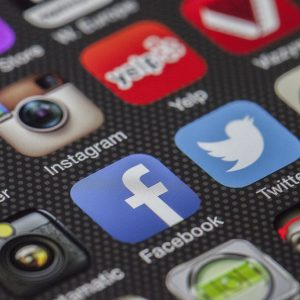 social media icons on a mobile device screen