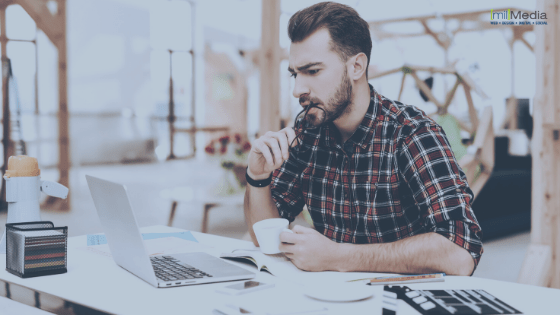 Man Sitting at Laptop Content Marketing and Working